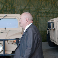 Csaba Hende Defence Minister for Hungary walks in front of a Hummer during the presentation of the Coalition Support Fund for Hungary by the US military in Szolnok, Hungary on July 18, 2011. ATTILA VOLGYI