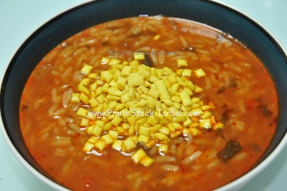 Tomato soup with Soup Almonds AKA soup mandel an Israeli food product consisting of crisp mini croutons that are added to soup at the table
