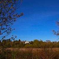 North America, Canada, Nova Scotia, Guysborough. View of DesBarres Manor Inn in Guysborough, from the Trans-Canada Trail.