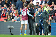 Tim Sherwood, the Aston Villa manager kisses Jack Grealish of Aston Villa as he is replaced for Joe Cole of Aston Villa. The FA Cup, semi final match, Aston Villa v Liverpool at Wembley Stadium in London on Sunday 19th April 2015.<br /> pic by John Patrick Fletcher, Andrew Orchard sports photography.