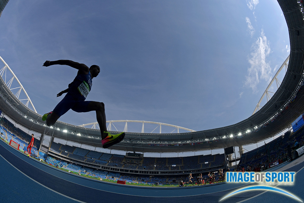 Aug 16, 2016; Rio de Janeiro, Brazil;  Christian Taylor (USA) during the men's triple jump final in the Rio 2016 Summer Olympic Games at Estadio Olimpico Joao Havelange.
