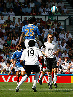 Photo: Steve Bond. <br />Derby County v Portsmouth. Barclays Premiership. 11/08/2007. Benjani outjumps Claude Davis