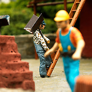construction worker models at the bekonscot model village in act of working.
