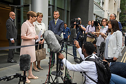 © Licensed to London News Pictures. 18/07/2018. London, UK. FRAN UNSWORTH (second left), Head of BBC News, stands next to JONATHAN MUNRO (fourth left), Head of Newsgathering, as she reads a statement to media outside the Rolls Building of the High Court in London where judges ruled in favour of a claim by Sir Cliff Richard for damages against the BBC for loss of earnings. The 77-year-old singer sued the corporation after his home in Sunningdale, Berkshire was raided following allegations of sexual assault made to Metropolitan Police. Photo credit: Ben Cawthra/LNP