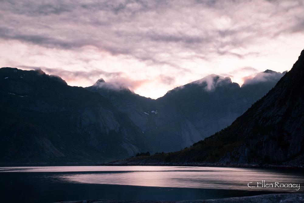 Sunset over mountains around Reine Fjord in Hamnoy, Moskenesoy, the Lofoten Islands, Norway