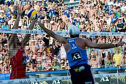 Ricardo Costa Santos of Bratil pokes ball over block of Sean Rosenthal at A1 Beach Volleyball Grand Slam tournament of Swatch FIVB World Tour 2010, on July 31, 2010 in Klagenfurt, Austria. (Photo by Matic Klansek Velej / Sportida)