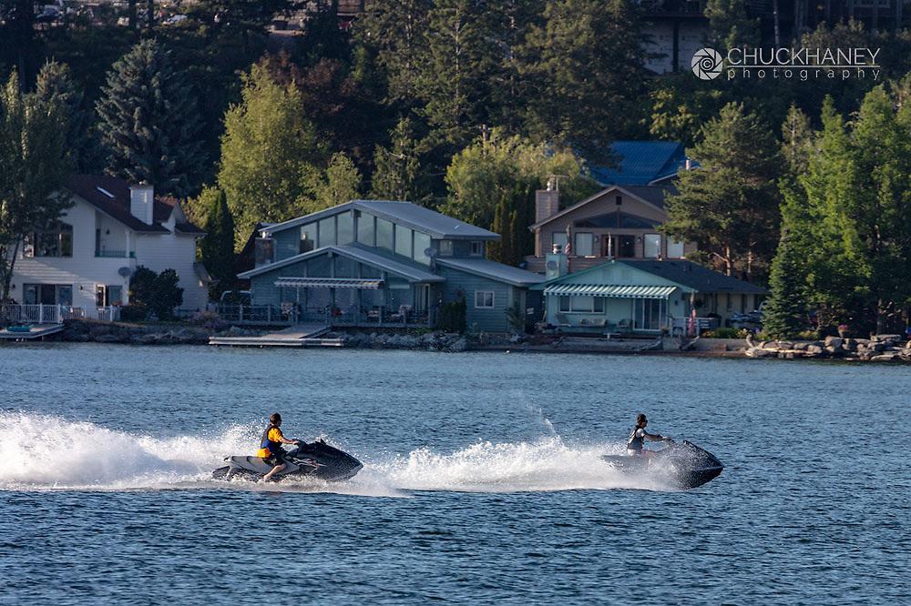 Jet skis on Flathead Lake from Wayfarers State Park in Bigfork, Montana, USA