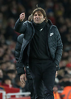 Football - 2017 / 2018 Premier League - Arsenal vs. Chelsea<br /> <br /> Antonio Conte, Manager of Chelsea FC, brandishes an imaginary card towards the linesman after his player Cesc Fabregas (Chelsea FC)  was booked for a foul at The Emirates.<br /> <br /> COLORSPORT/DANIEL BEARHAM