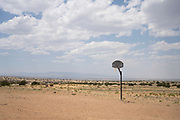 A basketball goal is seen on a dirt court in a remote part of White Rock Chapter in the Navajo Nation.