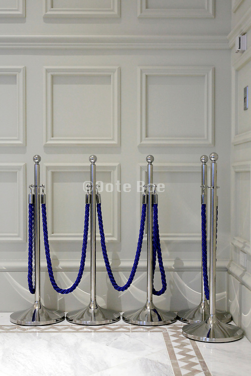 blue velvet queue rope placed at the side
