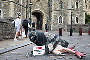 A bandaged giant pigeon holds a sign reading 'End Pigeon-Racing Cruelty' at a PETA UK protest outside Windsor Castle on 1st July 2020 in Windsor, United Kingdom. Animal rights charity PETA UK is calling on the Queen, who is currently isolating at Windsor Castle, to cut ties with pigeon racing following a PETA US investigation which revealed that all eight birds sent by the Queen to participate in the 2020 South African Million Dollar Pigeon Race SAMDPR died in quarantine and that fewer than a quarter of the birds from all over the world entered in the race subsequently complete it.