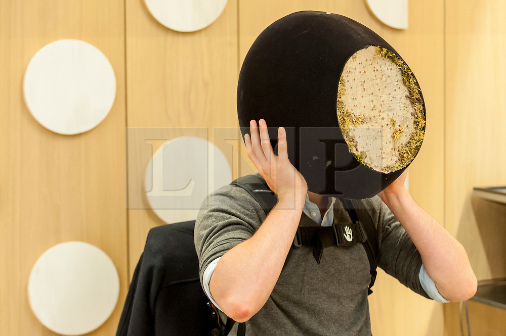 © Licensed to London News Pictures. 17/11/2016. London, UK. A visitor tests a virtual reality display as The Design Museum opens in its new home on Kensington High Street, west London.  Housed in the former Commonwealth Institute, the building has been redesigned by John Pawson following an investment of £83m, and a five-year construction process for its future role as the world's leading institution dedicated to contemporary design and architecture. Photo credit : Stephen Chung/LNP