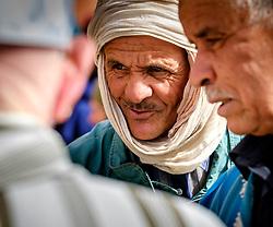 Berber men in conversation at the  carpet market in in Tazenakht, southern Morocco, Africa<br /> <br /> (c) Andrew Wilson   Edinburgh Elite media
