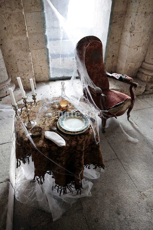 chair and set table with fake spider web in castle tower