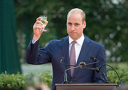 The Duke of Cambridge raises a toast to the Queen as he attends the Queen's Birthday Party at UK Ambassador's residence in Amman, Jordan at the start of his Middle East tour.