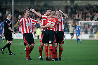 Photo: Pete Lorence.<br />Lincoln City v Rochdale United. Coca Cola League 2. 21/10/2006.<br />Team mates celebrate with Jamie Forrester after he scores his first goal.