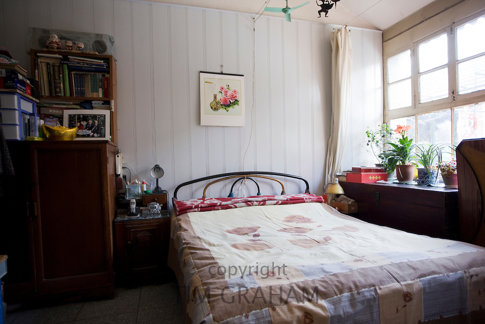 Typical bedroom in a home in the Hutongs area, Beijing, China