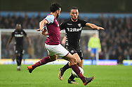 Aston Villa defender Neil Taylor (3) comes in to tackle Leeds United striker Kemar Roofe (7) during the EFL Sky Bet Championship match between Aston Villa and Leeds United at Villa Park, Birmingham, England on 13 April 2018. Picture by Dennis Goodwin.