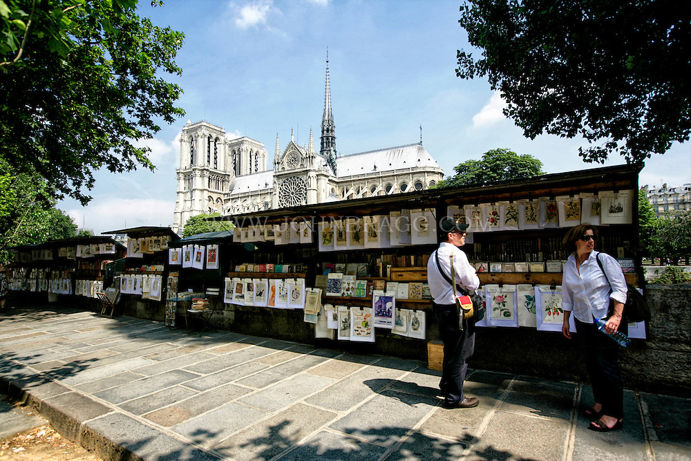 A Seine River art stand with a view of Notre Dame Cathedral, Paris, France