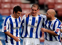 Photo: Glyn Thomas.<br />Huddersfield Town v Welling United. The FA Cup. 06/11/2005.<br />Huddersfield's Andrew Booth (C) is congratulated by Danny Schofield (L) and Danny Adams (R) after scoring his side's third goal.