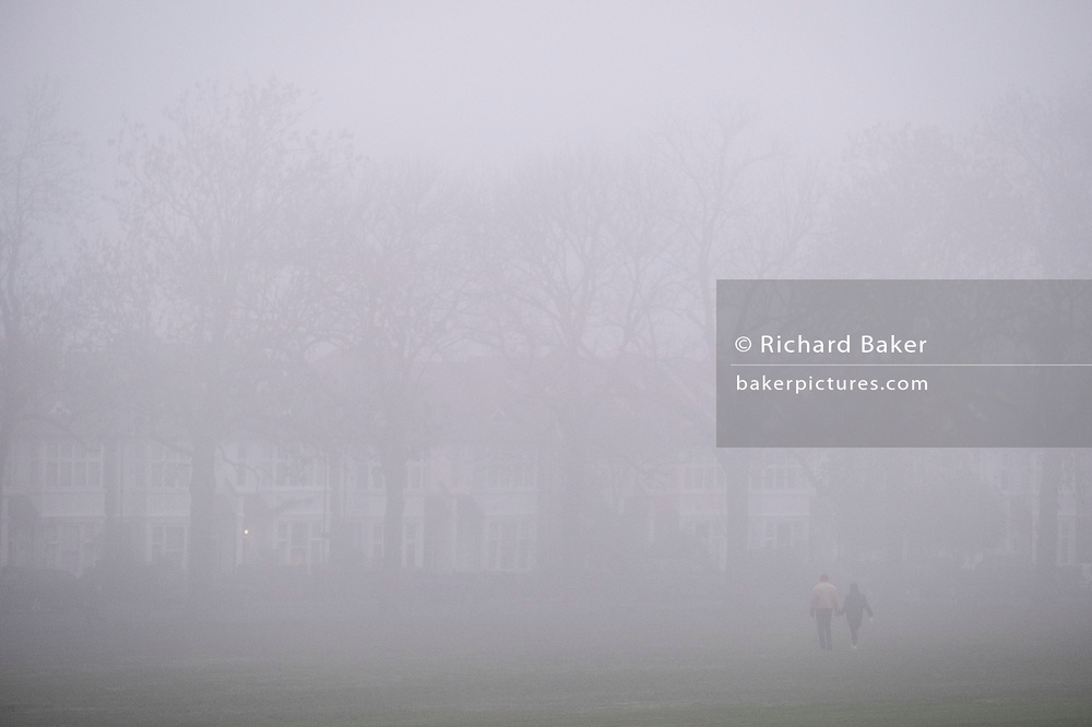 A couple walk hand in hand towards period homes bordering Ruskin Park in Herne Hill, on 27th November 2020, in London, England. (Photo by Richard Baker / In Pictures via Getty Images)