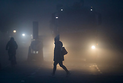© Licensed to London News Pictures. 08/12/2020. London, UK. Fog shrouds commuters at rush hour in Kensal Rise, West London for a second morning, as large parts of the UK wakes to further freezing temperatures. Photo credit: Ben Cawthra/LNP