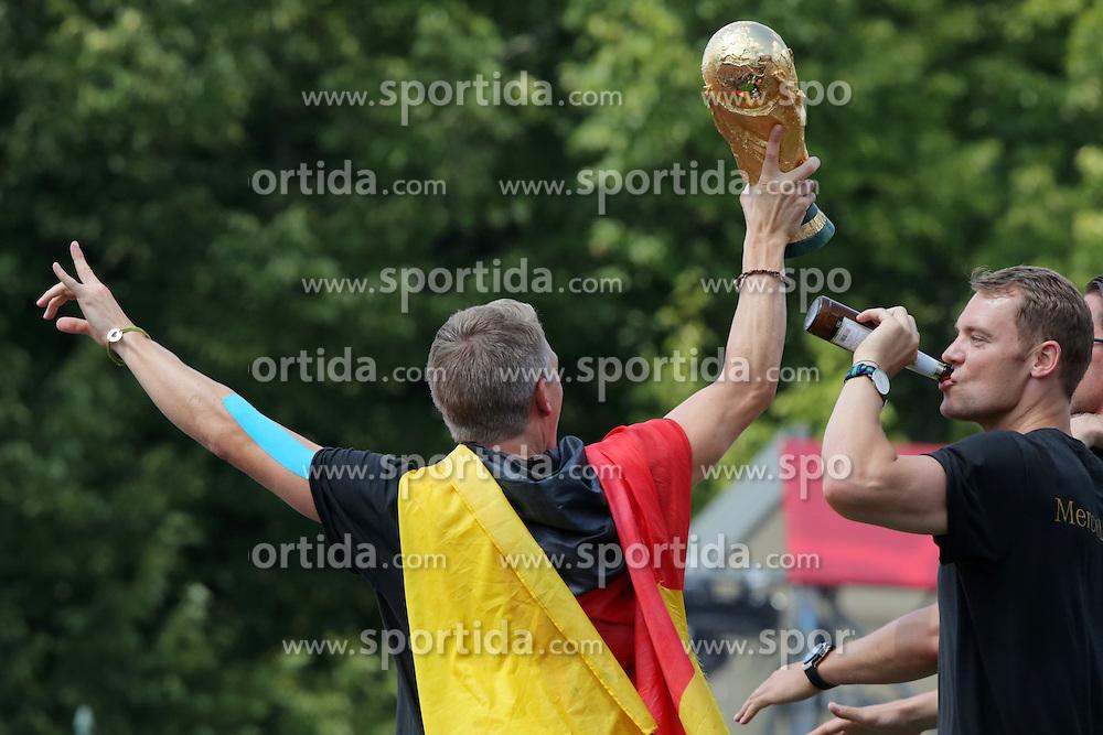 15.07.2014, Brandenburger Tor, Berlin, GER, FIFA WM, Empfang der Weltmeister in Deutschland, Finale, im Bild Manuel Neuer und Bastian Schweinsteiger feiern // during Celebration of Team Germany for Champion of the FIFA Worldcup Brazil 2014 at the Brandenburger Tor in Berlin, Germany on 2014/07/15. EXPA Pictures © 2014, PhotoCredit: EXPA/ Eibner-Pressefoto/ Hibbeler<br /> <br /> *****ATTENTION - OUT of GER*****