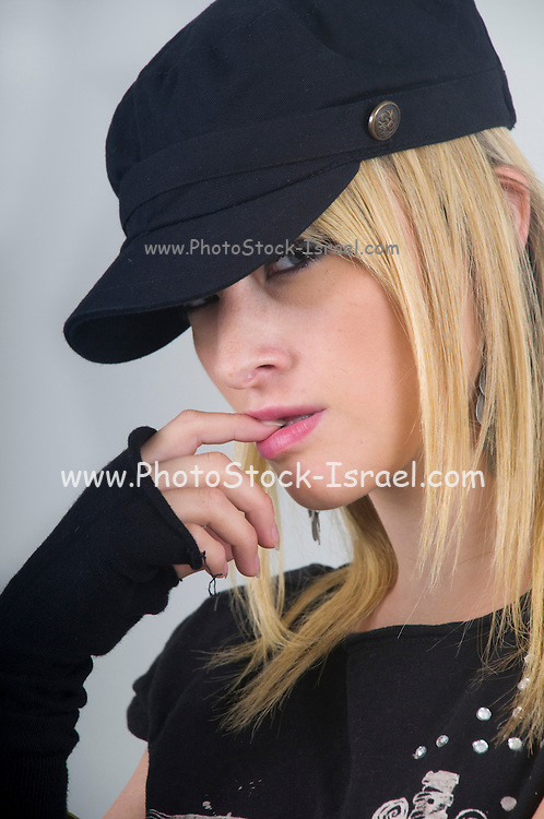 nonconformist young blond female teen with black skull T shirt