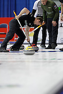 Carter Rycroft, second on Kevin Koe's team digs in as he sweeps home a rock in the team's first draw Wednesday.  The 2011 GP Car and Home Players' Championship ran April 12-17 at the Crystal Centre, Grande Prairie, AB..11-04-13, Photo Randy Vanderveen, Grande Prairie, Alberta.