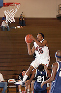Middletown, N.Y. - Orange County Community College men's basketball player Benjamim Bowman (15) leaps to the basket as Yves Keslin of Queensborough Community College defends during a game on Feb. 4, 2006. ©Tom Bushey