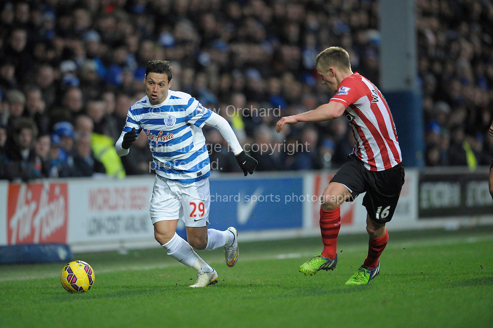 Mauro Zarate of QPR sprinting with the ball while James Ward-Prowse of Southampton chases. Barclays Premier league match, Queens Park Rangers v Southampton at Loftus Road in London on Saturday 7th Feb 2015. pic by John Patrick Fletcher, Andrew Orchard sports photography.