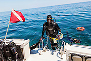 A SCUBA diver emerges from the water in the Sea of Abaco off Green Turtle Cay, Bahamas.