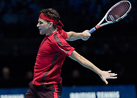 Tennis - 2017 Nitto ATP Finals at The O2 - Day Six<br /> <br /> Group Pete Sampras Singles: Dominic Thiem (Austria) Vs David Goffin (Belguim)<br /> <br /> Dominic Thiem (Austria) body position after a back hand return at the O2 Arena <br /> <br /> <br /> COLORSPORT/DANIEL BEARHAM