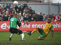 Photo: Rich Eaton.<br /> <br /> Tamworth FC v Norwich City. The FA Cup. 06/01/2007. Dion Dublin right of Norwich lobs the ball past Tamworth keeper Jose Veiga to make the score 4-0 in the second half