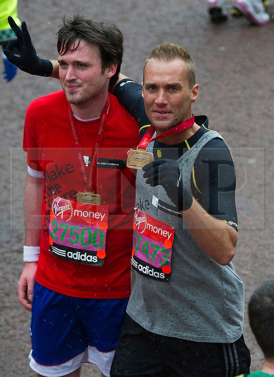 © London News Pictures. 22/04/2012. London, UK. Calum Best (right) at the finnish line at the 2012 Virgin London Marathon in London on April 22, 2012. Photo credit : Ben Cawthra /LNP