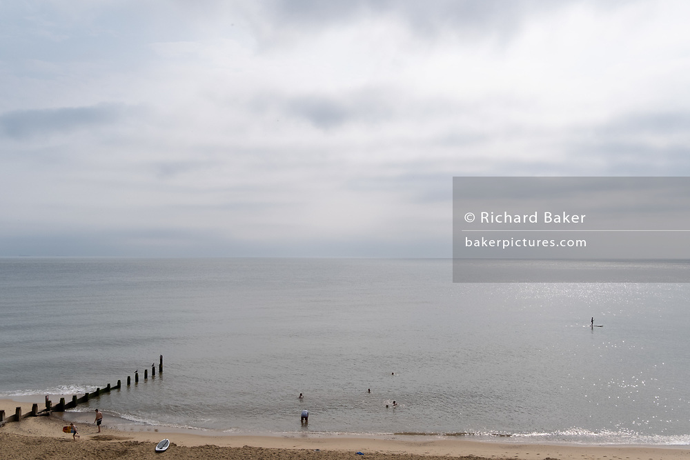 While other UK seaside resorts overcrowded during the Coronavirus pandemic,  staycationers enjoy calm seas on the Norfolk coast, on 14th August 2020, in Southwold, Norfolk, England.
