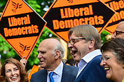 Guy Verhofstadt, Leader of the Alliance of Liberals and Democrats for Europe Party and the European Parliaments chief Brexit negotiator right laughs as he speaks to the media during a European Parliament elections campaign event with Liberal Democrat leader Sir Vince Cable left and party activists before canvassing for support for their candidates in the forthcoming European elections, on 10th May 2019 in Camden, North London, England, United Kingdom. Sir Vince Cable said the partys message was to stop Brexit.