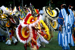 American Indians in Feathered Costumes on Reservation