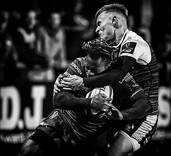 Niyi Adeolokun of Connacht is tackled by Harri Morgan of Ospreys<br /> <br /> Photographer Simon King/Replay Images<br /> <br /> Guinness PRO14 Round 7 - Ospreys v Connacht - Friday 26th October 2018 - The Brewery Field - Bridgend<br /> <br /> World Copyright © Replay Images . All rights reserved. info@replayimages.co.uk - http://replayimages.co.uk