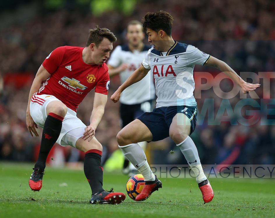 Phil Jones of Manchester United tussles with Son Heung-Min of Tottenham during the English Premier League match at Old Trafford Stadium, Manchester. Picture date: December 11th, 2016. Pic Simon Bellis/Sportimage