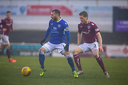 Queen of the South's Stephen Dobbie and Arbroath's Colin Hamilton. Arbroath 2 v 0 Queen of the South, Scottish Championship game played 15/2/2020 at Arbroath's home ground, Gayfield Park.