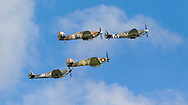 Members of the public watch Spitfires and other World War II aircraft take off from Goodwood airfield near Chichester as the country marked the 75th anniversary of the Battle of Britain. <br /> Picture date Tuesday 15th September, 2015.<br /> Picture by Christopher Ison. Contact +447544 044177 chris@christopherison.com