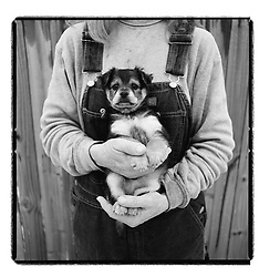 2/19/03 Joann Hager, founder of Tri-County Animal Rescue, holds Jasper, a pomeranian mix puppy. Hager and her husband Doug, both Duke Energy employees, began the non-profit animal shelter five years ago. It is now home to 150-175 dogs, cats and some other animals as they wait to be placed in loving homes. L.MUELLER/staff photo