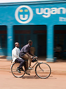A local taxi-bike travelling down a street in Kabale, Uganda