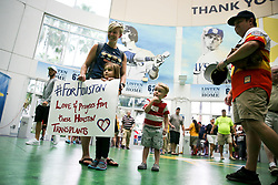 August 29, 2017 - St. Petersburg, Florida, U.S. - WILL VRAGOVIC   |   Times.Katie Churchwell, 32, of St. Petersburg, holds a sign with her daughter, Addison 4, while her son, Crawford, 3, and husband, Logan, 30, look on in the Rotunda at Gate 1 at Tropicana Field in St. Petersburg, Fla. on Tuesday, Aug. 29, 2017. The Churchwells moved to St. Petersburg from Houston almost exactly one year ago. Katie is an Episcopal minister, and has been in touch with people from the church where she used to serve on the north side of Houston. ''Almost every single one of my parishioners has their house flooded and are out of their homes,'' she said. (Credit Image: © Will Vragovic/Tampa Bay Times via ZUMA Wire)