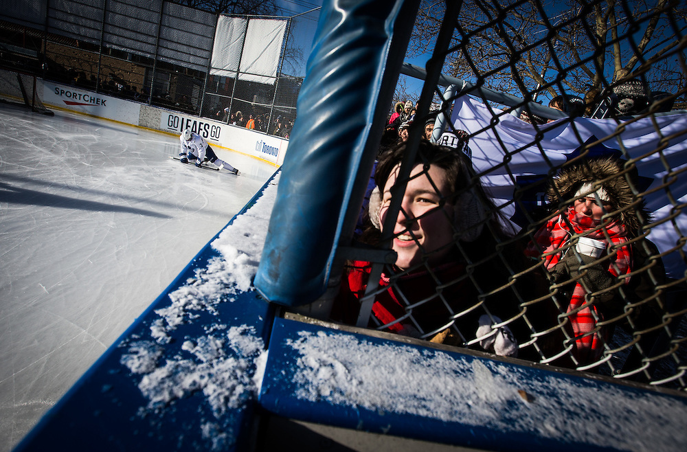 People watch the  Toronto Maple Leafs outdoor practice in Toronto, January 5, 2015.