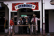 Actors & visitors talk in front of Saloon, Helldorado Days, Tombstone, Arizona. ©Edward McCain/McCain Creative, Inc. All Rights Reserved 520-623-1998