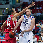 Anadolu Efes's Dusko SAVANOVIC (R) during their Two Nations Cup basketball match Anadolu Efes between Olympiacos at Abdi Ipekci Arena in Istanbul Turkey on Sunday 02 October 2011. Photo by TURKPIX