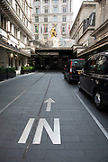 Entrance road to the Savoy Hotel in London, United Kingdom. This is the only street in the UK where vehicles drive on the right hand side, allowing taxis in and out in a loop. The Savoy Hotel is a hotel located on the Strand, in central London. Built by impresario Richard DOyly Carte, the hotel opened on 6 August 1889. It was the first in the Savoy group of hotels and restaurants owned by Cartes family for over a century. It was also the first luxury hotel in Britain, introducing electric lights throughout the hotel, electric lifts, bathrooms inside most of the lavishly furnished rooms, constant hot and cold running water and many other innovations.