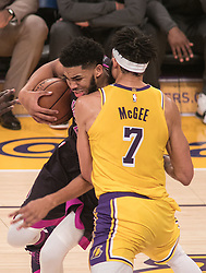 January 24, 2019 - Los Angeles, California, U.S - Karl-Anthony Towns #32 of the Minneapolis Timberwolves drives against JaVale McGee#7 of the Los Angeles Lakers during their NBA game on Thursday January 24, 2019 at the Staples Center in Los Angeles, California. Lakers lose to Timberwolves, 105-120. (Credit Image: © Prensa Internacional via ZUMA Wire)